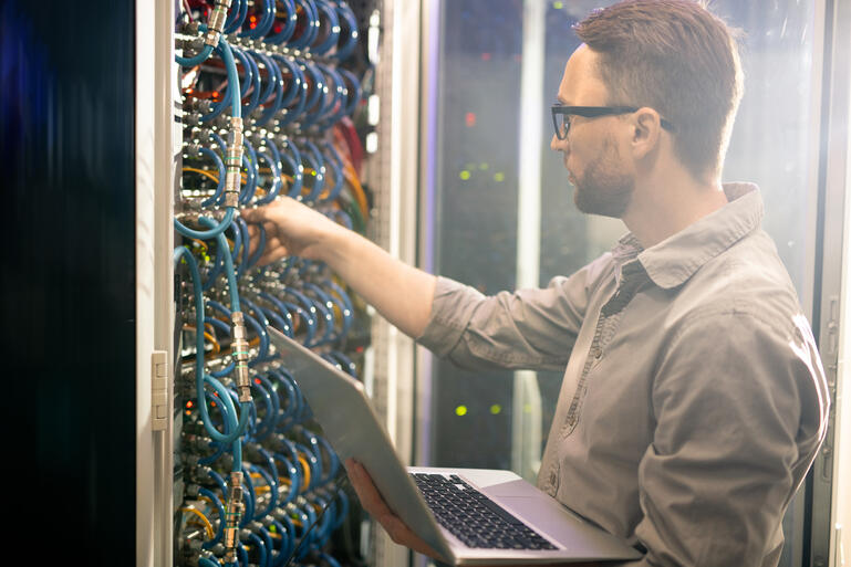 engineer-analyzing-server-connections-YJR5EWM