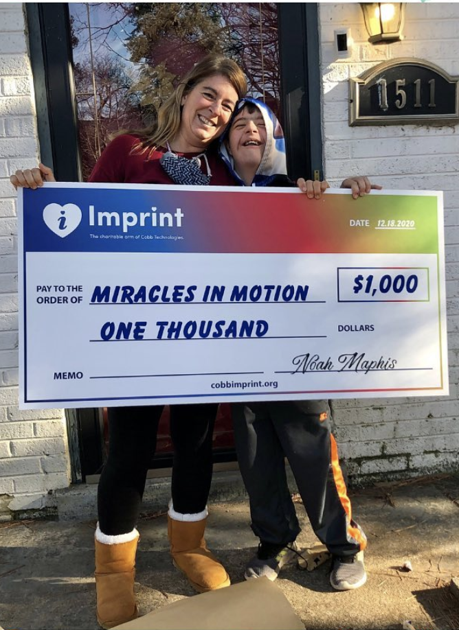 2020 Check presentation to Miracles in Motion